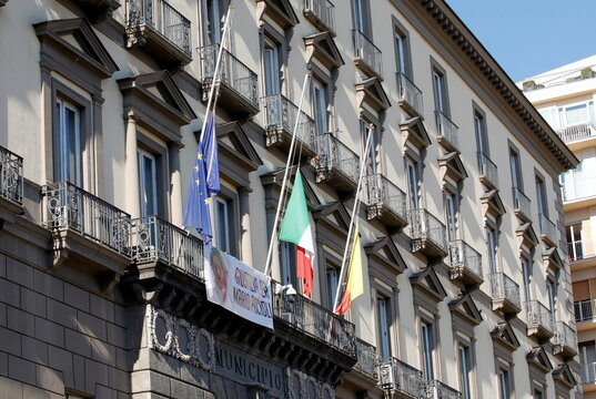 Flags fly at half-mast on Naples town hall following the death of Argentine soccer legend Diego Maradona, in Naples
