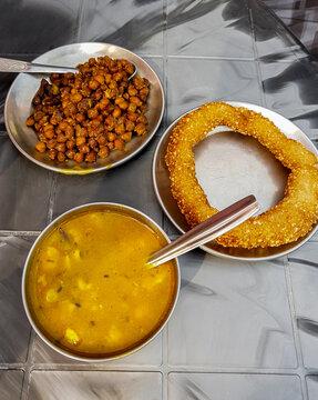 Nepalese food breakfast with Sel Roti and chickpeas. Kathmandu, Nepal.