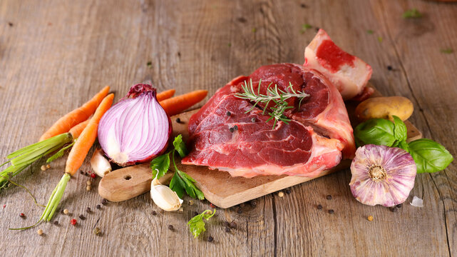 raw beef and vegetable on wooden board