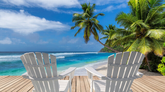 Vacations Sunny beach with white beach chairs on wooden floor, palm trees and the turquoise sea on Tropical island.