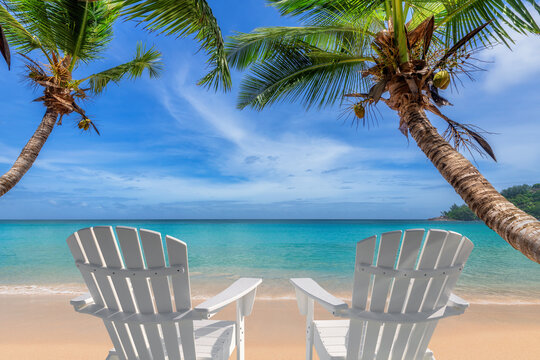 Paradise beach with white sand, beach chairs and coco palms in Caribbean sea. Summer vacation and tropical beach concept.