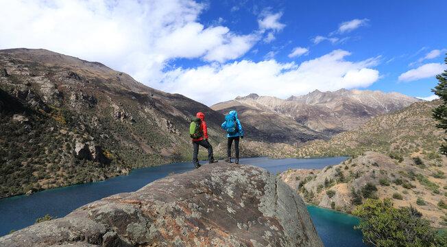Two women backpackers hiking  in beautiful winter mountains