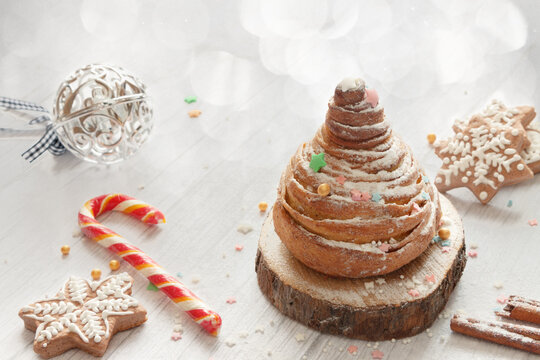 Homemade Christmas cakes white bokeh wooden background with copy space