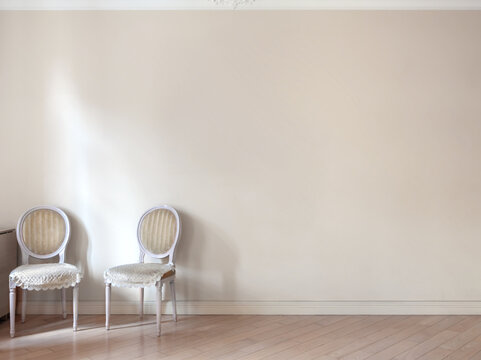 Two retro chairs in the corner of the yellow room mockup wall copy space background