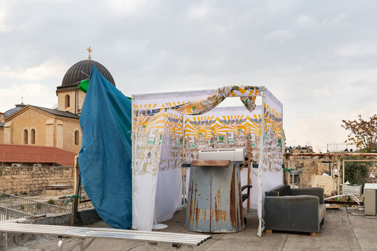 The Jewish holiday hut Sukkah on the roof of the house in the old city of Jerusalem, in Israel