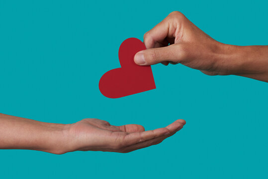 person giving a heart to another person