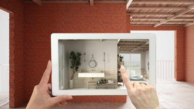 Augmented reality concept. Hand holding tablet with AR application used to simulate furniture and design products in interior construction site, wooden peaceful bathroom with sink