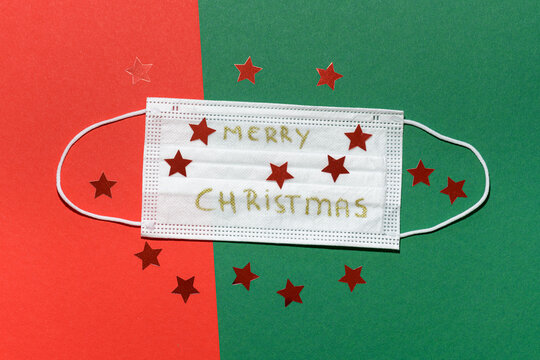 Non-medical face mask with Merry Chrismas wishes on a red green background and red stars