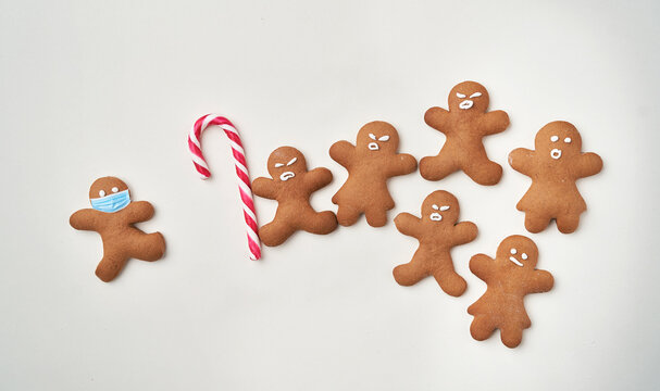 Funny gingerbread man shaped cookies with facial masks