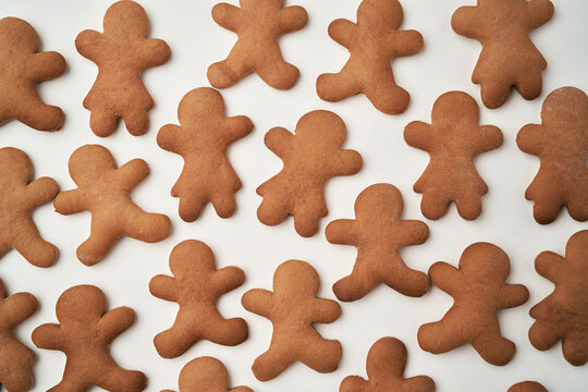 Top view of gingerbread man cookies on white background
