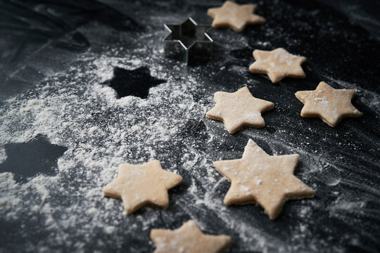 Close up of raw Christmas cookies on black background