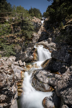 Idyllic view of waterfall in forest, Spanish Pyrenees mountain