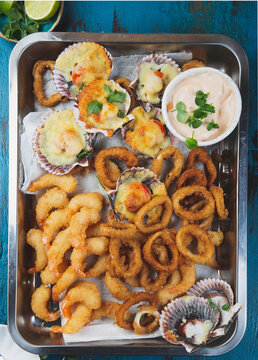 Seafood hot platter - Fried squids rings, Baked ostiones and fried shrimps baked with sauce