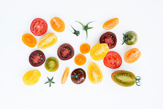 Colourful tomato slices on a white background