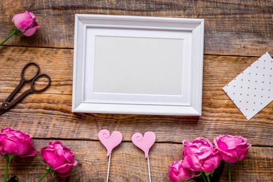 Mother's day gift with peony flowers and frame top view mockup