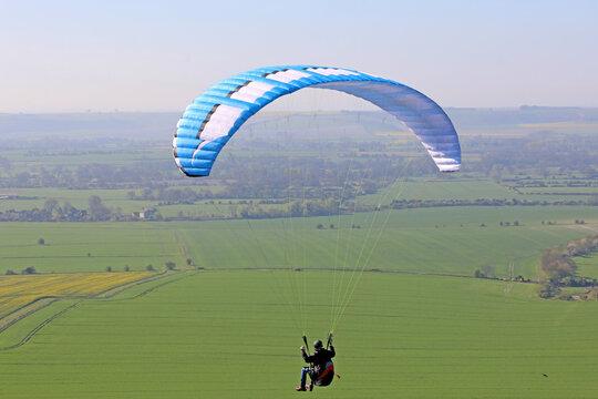 Paraglider flying at Milk Hill, Wiltshire