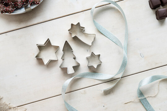 Cutters and ribbon on a white surface