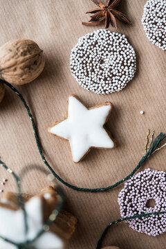 Christmas biscuits, a walnut and star anise on brown paper