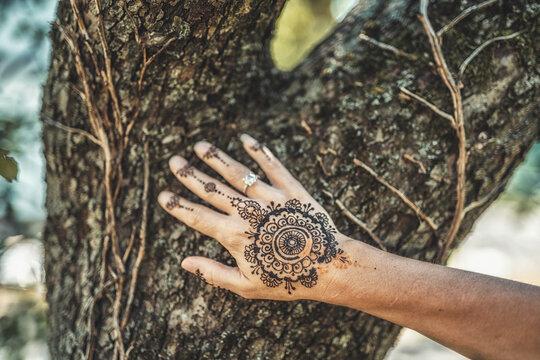 Henna art on woman's hand.