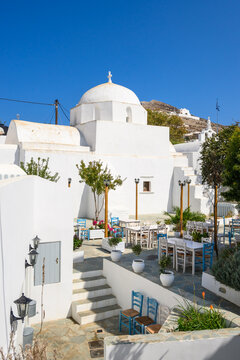 Small square with church building on street in beautiful Chora town on Folegandros Island, Cyclades, Greece.