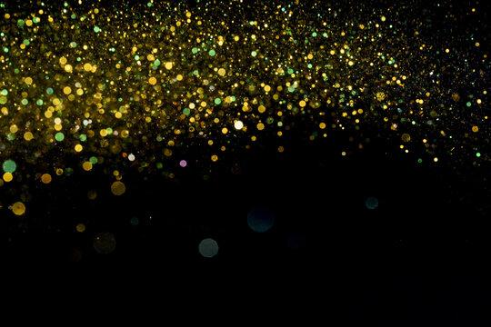 Closeup shot of beautiful yellow glitter on black background