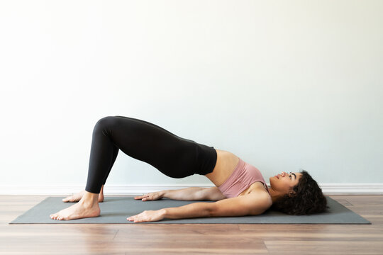 Female yogi practicing a bridge yoga pose