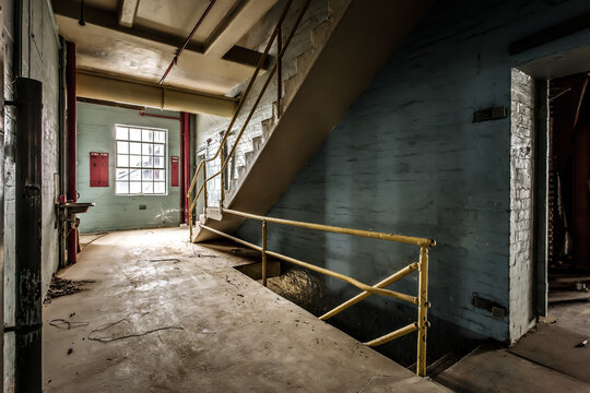 Abandoned building with industrial spooky stairs