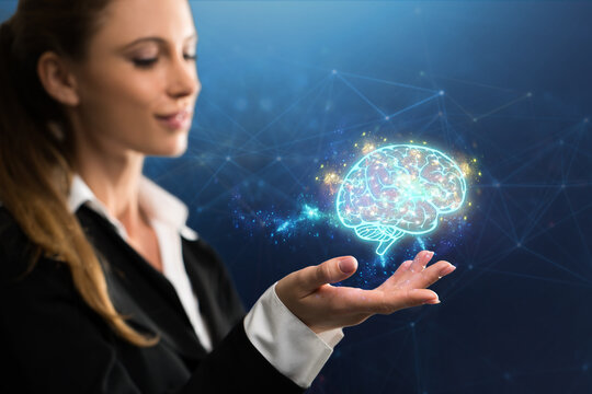 businesswoman interacting with a virtual brain in front of blue background