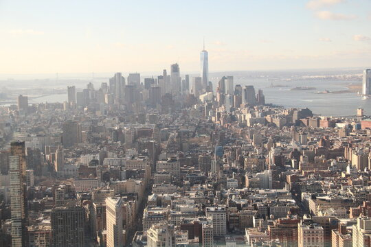 New York Harbor and its skyscrapers from 86th floor of Empire State Building.