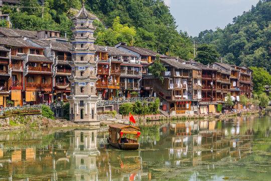 Riverside buildings and Wanming Pagoda in Fenghuang Ancient Town, Hunan province, China
