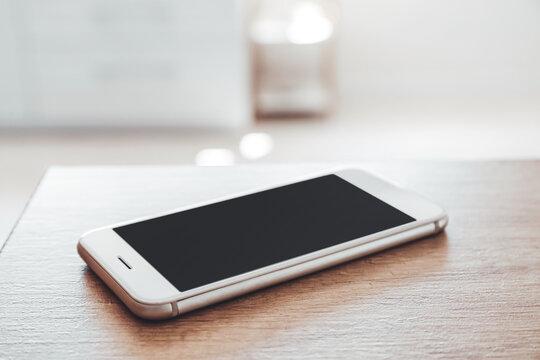 Modern mobile phone on table, closeup