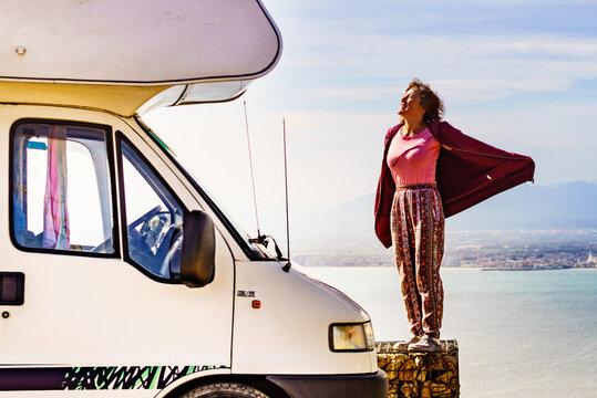 Woman enjoy caravan vacation.