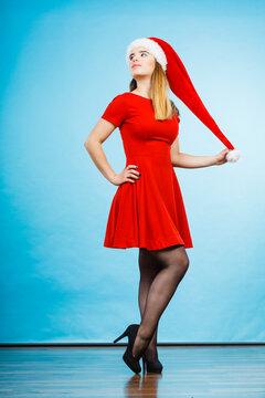 Woman wearing Santa Claus helper costume dress