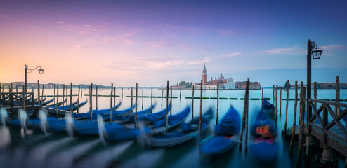 Venice lagoon, San Giorgio church and gondolas at sunrise. Italy