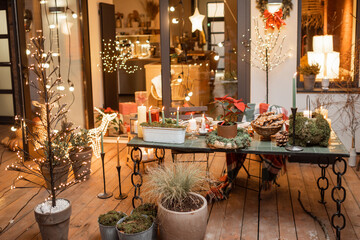 Beautifully decorated backyard of a country house with a festive dinner table during the New Year...