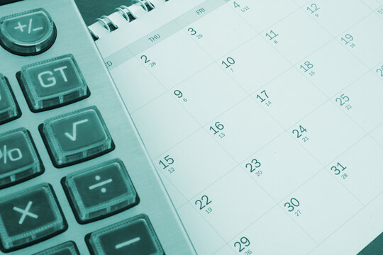 Accounting concept, calculator on calendar background