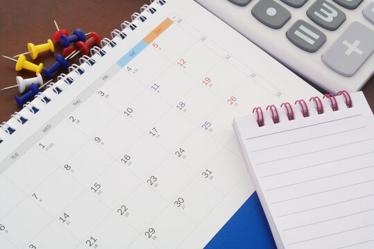Calendar, push pins, notepad and calculator. Planning and counting concept.