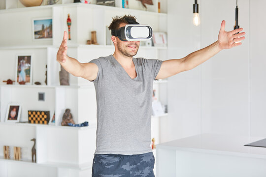Man explores house with VR glasses for spatial planning