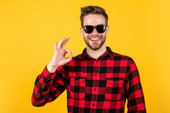 his perfect style. handsome man wear checkered shirt. unshaven guy in casual style. male hairdresser and barbershop. male beauty trend. bearded man with bristle in glasses. facial hair and skin care