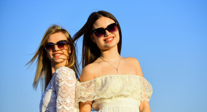 Female friendship. Female power. Summer fashion. Find woman inner strength. Harmony and balance. Femininity concept. Beautiful women on sunny day blue sky background. Sisterhood and female community