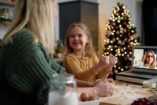 Happy little girl helping during Christmas baking