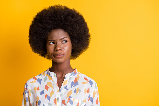 Photo of attractive lady thinking look empty space trying to make decision isolated on yellow color background