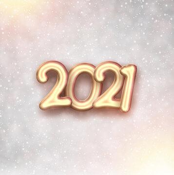 Golden foil balloon 2021 sign on blurred background.