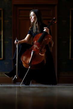 French-Belgian cellist Camille Thomas plays at the empty Musee des Arts Decoratifs in Paris