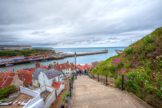 View for Whitby port, city and pier from stairs leading to historical abbey.