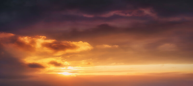 background of cloudscape at the sunset with sunshine on sky and orange clouds