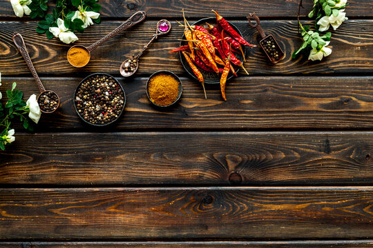 Set of various hot spices and herbs in a bowls. Top view, copy space.