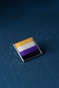 non-binary pride flag in a pin button