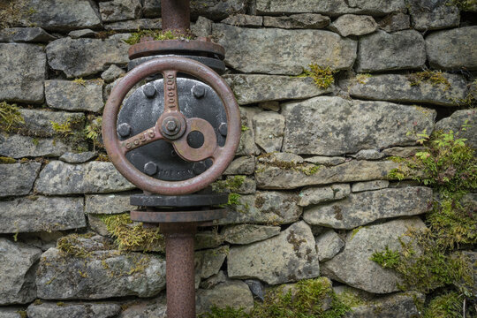 historic pipework on an old wall