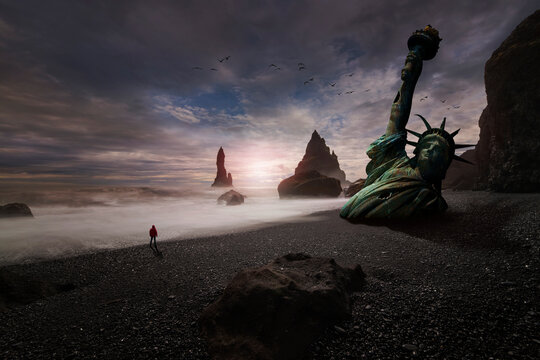Statue of Liberty half buried in the sand on the beach